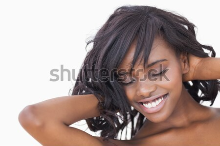 Woman ruffling her hair smiling  Stock photo © wavebreak_media