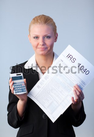 Businesswoman scrolling through virtual newspaper Stock photo © wavebreak_media