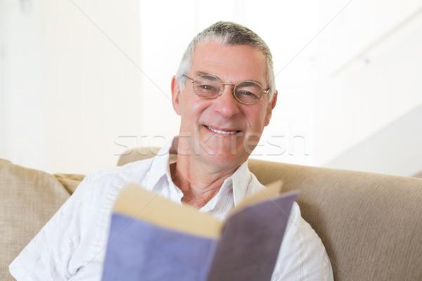 Handsome senior man with book Stock photo © wavebreak_media