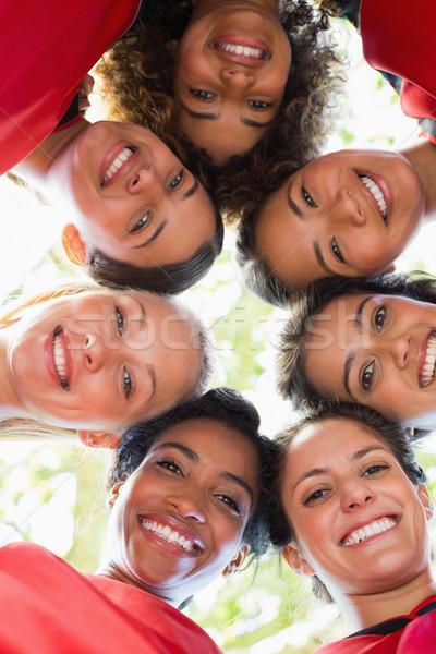 Female soccer team forming huddle Stock photo © wavebreak_media