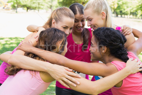 Participants of breast cancer marathon forming huddle Stock photo © wavebreak_media