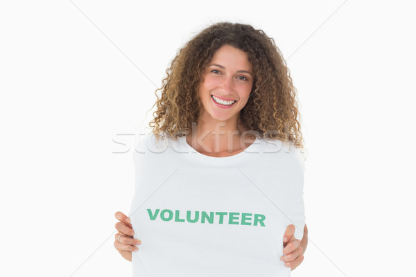 Smiling volunteer showing her tshirt to camera Stock photo © wavebreak_media