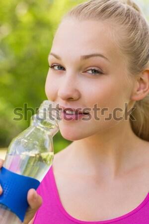 Beautiful serious woman looking away in park Stock photo © wavebreak_media
