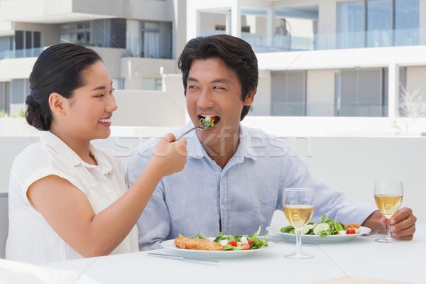 Feliz casal refeição juntos fora varanda Foto stock © wavebreak_media