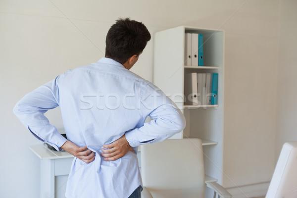 Casual businessman touching his sore back Stock photo © wavebreak_media