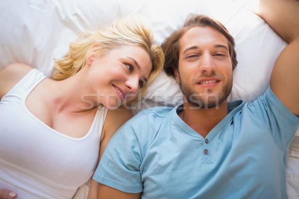 Happy couple relaxing on bed  Stock photo © wavebreak_media
