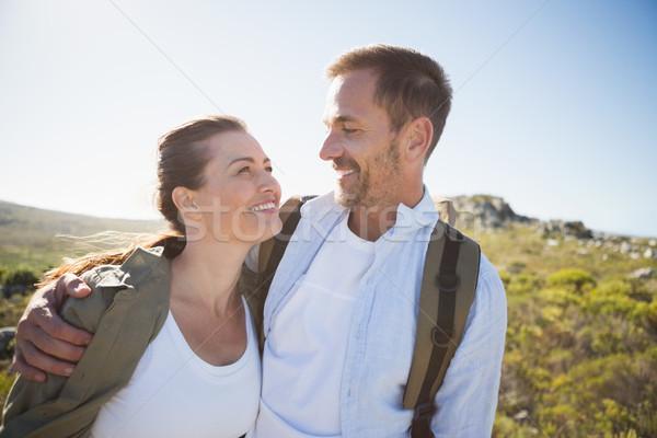 ハイキング カップル 笑みを浮かべて 国 地形 ストックフォト © wavebreak_media
