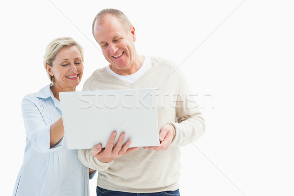 Happy mature couple using laptop Stock photo © wavebreak_media