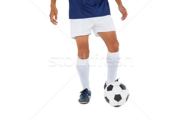 Stock fotó: Futballista · kék · rúg · labda · fehér · sport