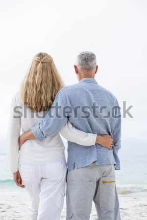 Happy couple standing with arms around Stock photo © wavebreak_media