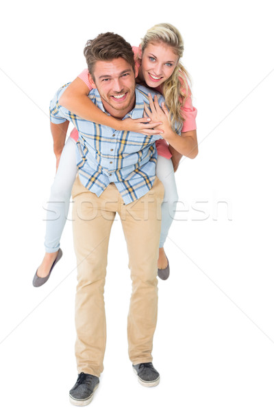 Handsome man giving piggy back to his girlfriend Stock photo © wavebreak_media