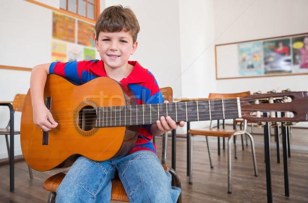 Aranyos játszik gitár osztályterem általános iskola iskola Stock fotó © wavebreak_media