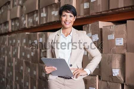 Entrepôt gestionnaire inventaire affaires heureux Photo stock © wavebreak_media