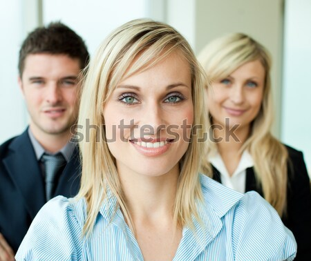 Happy business people with arms crossed in office Stock photo © wavebreak_media