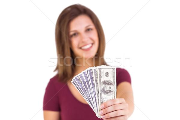 Festive brunette in dress showing her cash Stock photo © wavebreak_media
