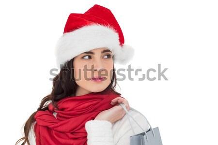 Brunette in santa hat holding shopping bag Stock photo © wavebreak_media