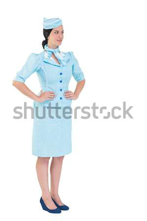 Pretty air hostess with hands on hips Stock photo © wavebreak_media