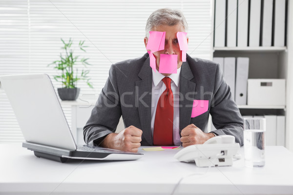 Overwhelmed businessman with sticky notes on head Stock photo © wavebreak_media