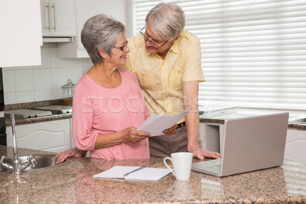 Senior couple paying their bills with laptop Stock photo © wavebreak_media