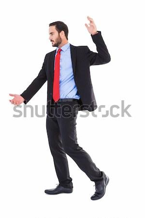 Focused businessman holding something with his hands Stock photo © wavebreak_media