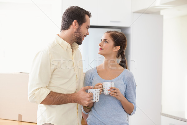 Young couple smiling at each other Stock photo © wavebreak_media