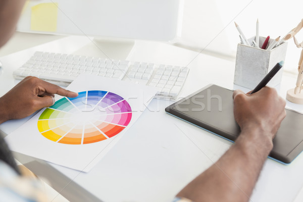 Businessman using colour sample and digitizer Stock photo © wavebreak_media