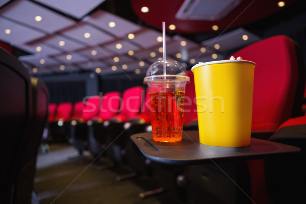 Empty rows of red seats with pop corn and drink on the floor Stock photo © wavebreak_media