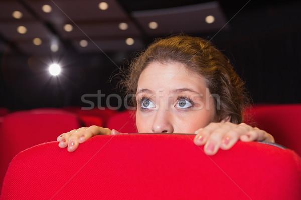 Młoda kobieta oglądania scary film kina film Zdjęcia stock © wavebreak_media