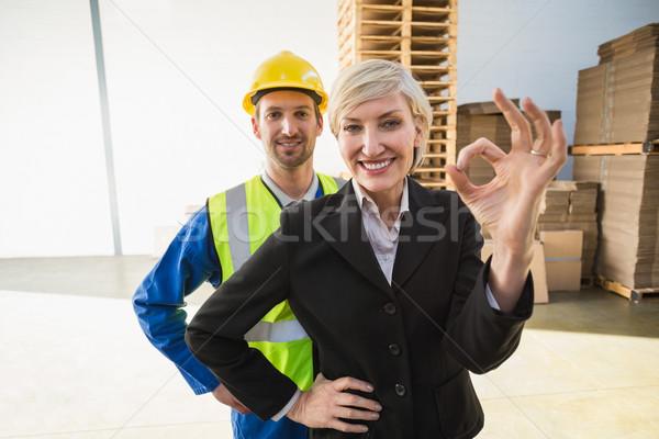 Happy businesswoman making okay gesture Stock photo © wavebreak_media