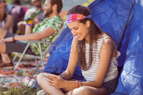 Carefree hipster sending text message Stock photo © wavebreak_media