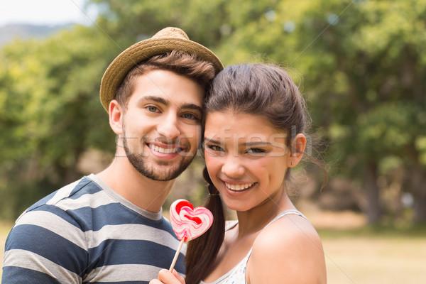 Cute couple lollipop arbre Photo stock © wavebreak_media