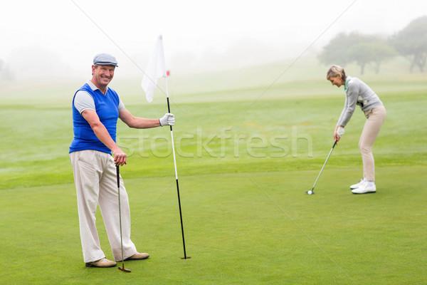 Golf couple golf brumeux jour femme Photo stock © wavebreak_media