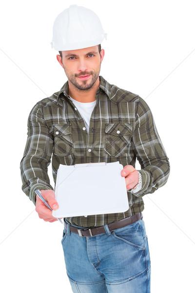 Sorridente manual trabalhador clipboard assinatura branco Foto stock © wavebreak_media