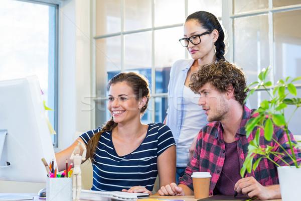 Gülen ortaklar bilgisayar ofis adam Stok fotoğraf © wavebreak_media