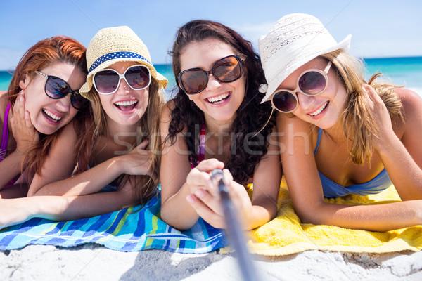 Happy friends wearing sun glasses and taking selfie Stock photo © wavebreak_media