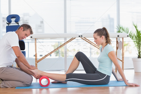 Trainer working with woman on exercise mat  Stock photo © wavebreak_media