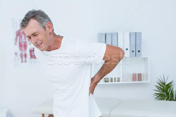 страдание пациент прикасаться назад медицинской служба Сток-фото © wavebreak_media