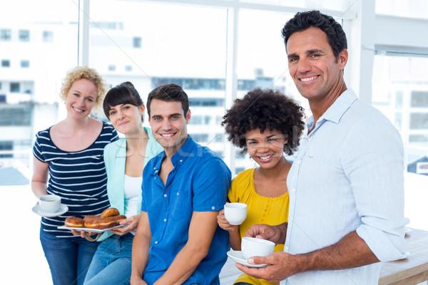 Pessoas de negócios alimentação potável jovem mulher Foto stock © wavebreak_media