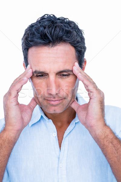 Handsome man thinking with hand on forehead Stock photo © wavebreak_media