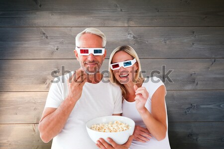 Happy couple wearing 3d glasses eating popcorn Stock photo © wavebreak_media