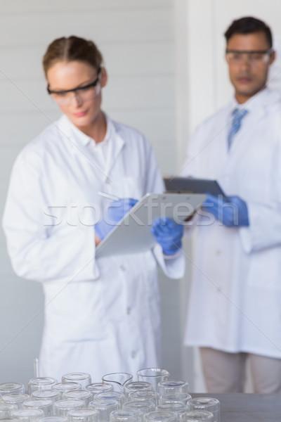 Koncentrált tudósok néz nő orvosi tudomány Stock fotó © wavebreak_media