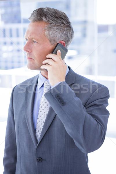 Ansioso empresário telefone escritório telefone terno Foto stock © wavebreak_media