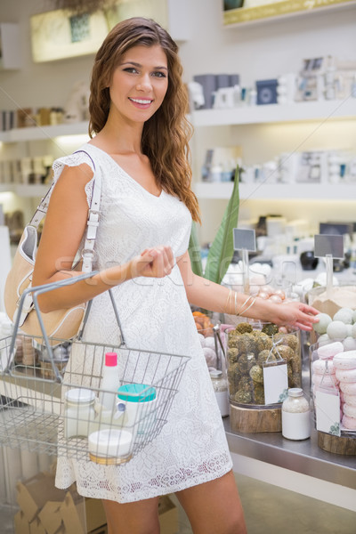 Stock photo: Portrait of smiling woman with shopping basket looking at camera