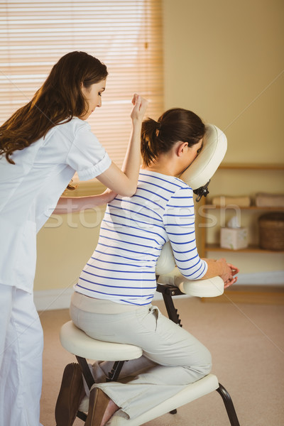 Young woman getting massage in chair Stock photo © wavebreak_media