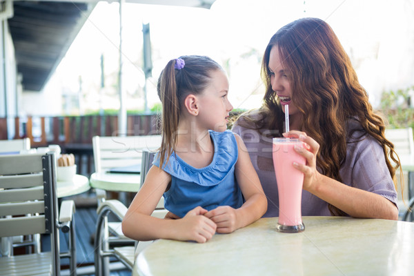 Mother and daughter sitting outside the cafe Stock photo © wavebreak_media
