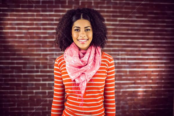 привлекательный улыбаясь портрет красный кирпичных Сток-фото © wavebreak_media