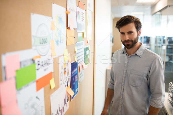 Portrait of businessman standing by soft board Stock photo © wavebreak_media