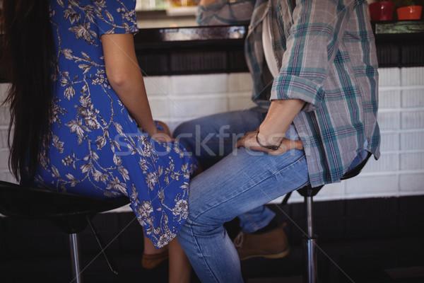 Basso sezione Coppia seduta bar sgabello Foto d'archivio © wavebreak_media