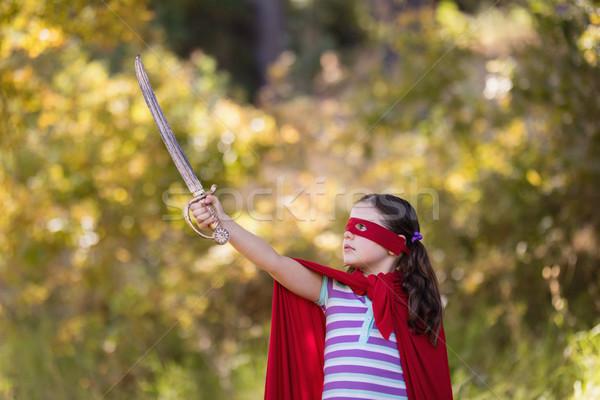 Kislány tart kard visel szuperhős jelmez Stock fotó © wavebreak_media