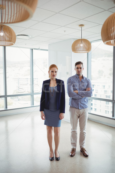 Portrait of smiling executives standing together Stock photo © wavebreak_media